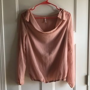 Peachy colored blouse